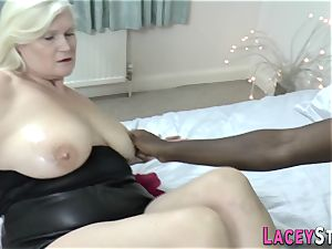 Lacey Starr Gives a Footjob to a dark-hued guy