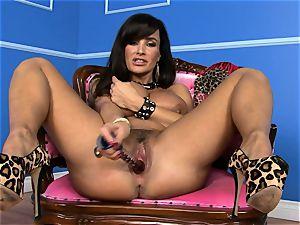 gorgeous Lisa Ann stuffs her fake penis deep in her wet twat