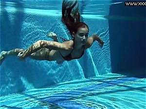 Tiffany Tatum takes off nude underwater
