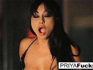 huge-boobed Priya Rai rails the sybian at the strip club