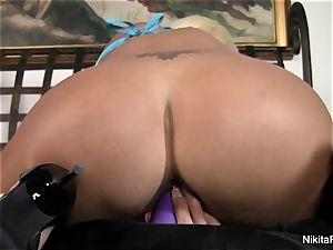 hot platinum-blonde Nikita plays with a purple fucktoy